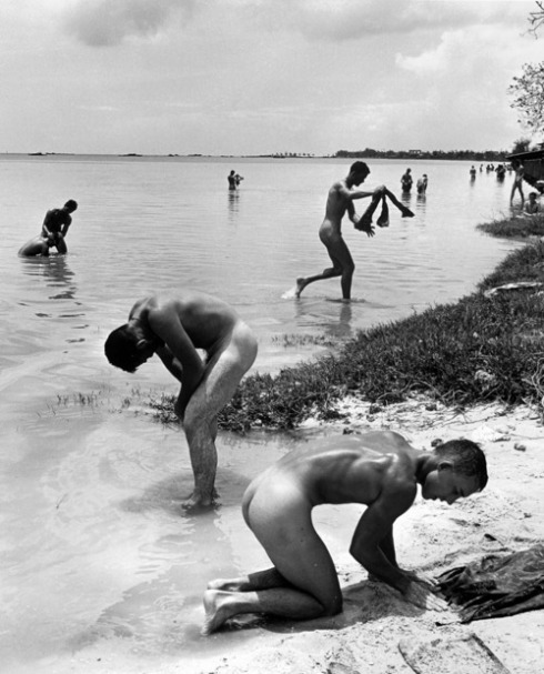 American troops in the Pacific bathe during a lull in the fighting on the island of Saipan, 1944. PETER STACKPOLE