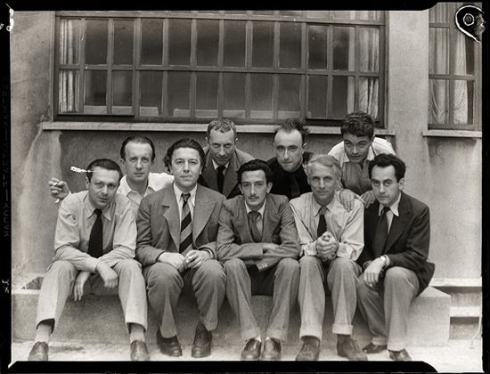 Surrealists Tristan Tzara, Paul Éluard, André Breton, Hans Arp, Salvador Dalí, Yves Tanguy, Max Ernst, René Crevel and Man Ray, Paris 1933. Photo- Anna Riwkin.