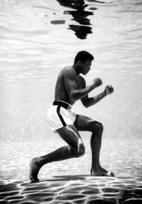 Muhammad Ali training under water in St John's Hotel pool, Miami. 1961