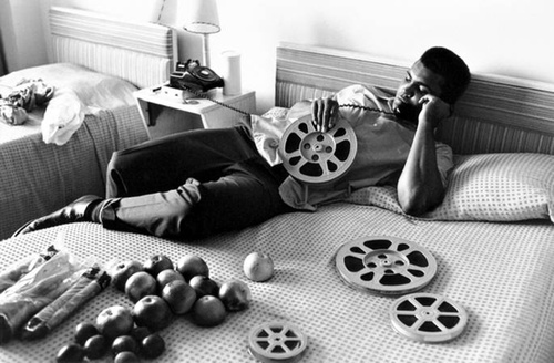 Ali Looking at Film Reels