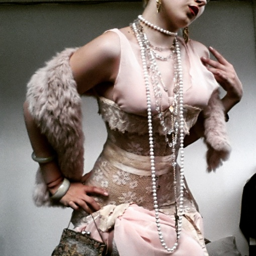 Berlin night out to the unfamous Kit Kat Klub. Antique corset, transparent dress, various religious necklaces. Worned with pink stilettos.